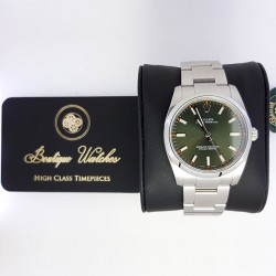 Rolex Oyster Perpetual 114200 - cadran verde